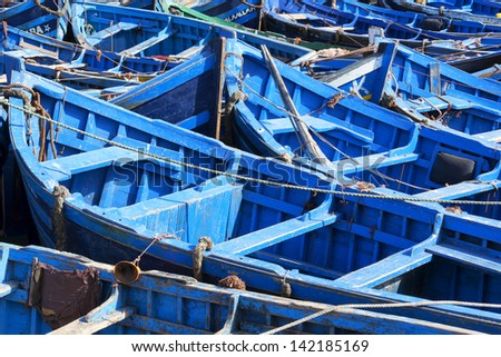 Blue fishing boats in Essaouira, Morocco. - stock photo