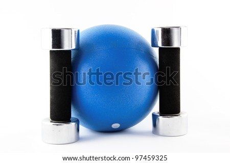 Blue fitness ball with silver hand weights standing straight - stock photo