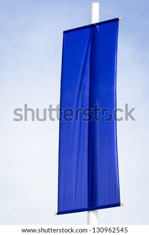 blue flag in front of blue sky - stock photo