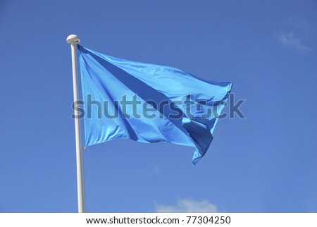 Blue flag waving on the sky. Promotional and advertisement element