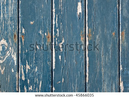 Blue flaky paint on a wooden fence. - stock photo