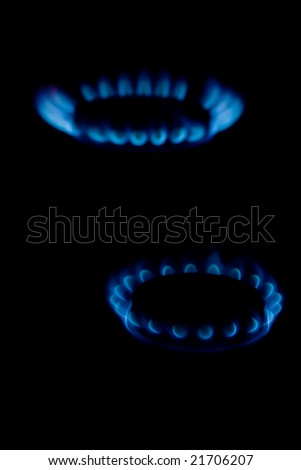 Blue flame of gas on a black background - stock photo