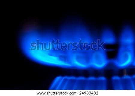 Blue Flames burning from a gas stove. - stock photo