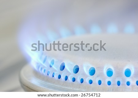 Blue flames of a gas stove. - stock photo