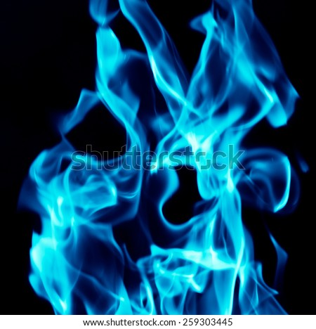Blue flames on a black background - stock photo