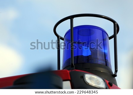 blue flashing light on the fire vehicle - stock photo