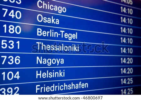 Blue flight information board in airport, selective focus - stock photo