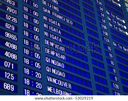Blue flight information board in airport, selective focus. - stock photo