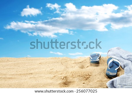 blue flip flops and towel  - stock photo