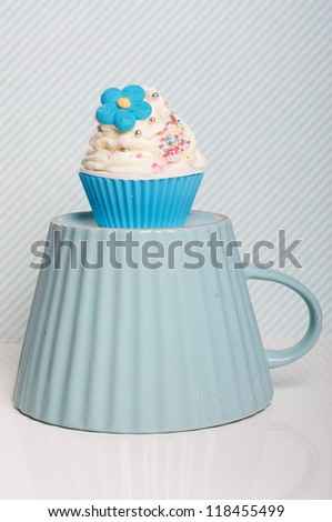 blue flower cupcake on a big cup - stock photo
