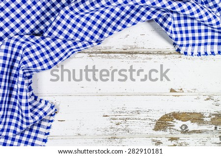 Blue folded tablecloth over wooden table
