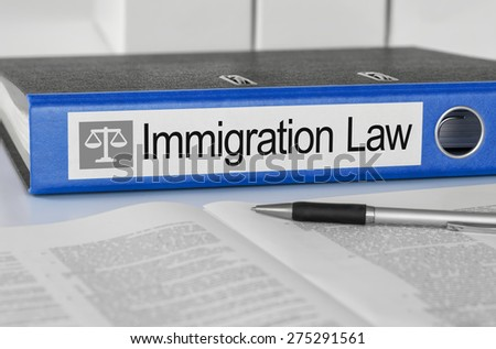 Blue folder with the label Immigration Law - stock photo