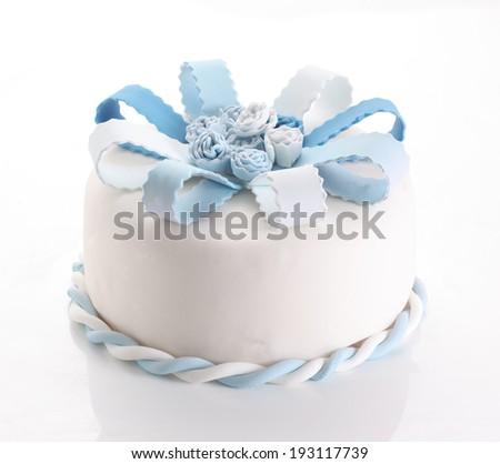 Blue fondant cake with bow - stock photo