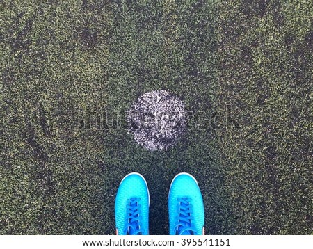Blue football boots. Blue soccer boots on soccer field. - stock photo