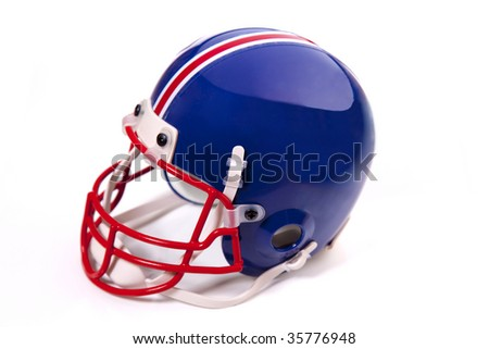 Blue Football helmet with chinstrap, red facemask, and pinstripe on white. - stock photo