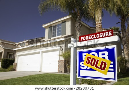 Blue Foreclosure For Sale Real Estate Sign in Front of House. - stock photo