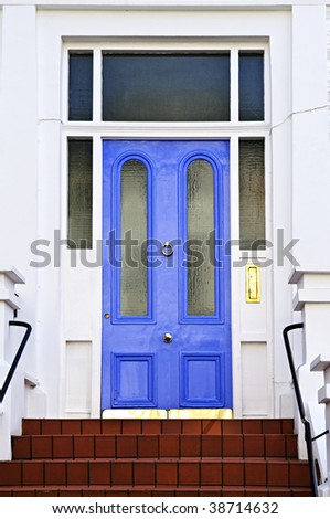 Blue front door with brass knocker in London England