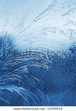 blue frosty natural pattern on winter window - stock photo
