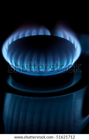 Blue gas burner flame with reflection