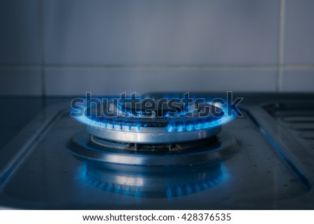 blue gas burning from old kitchen gas stove - stock photo