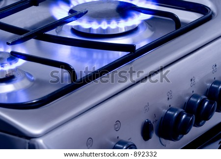 Blue gas flames - stove burner - stock photo