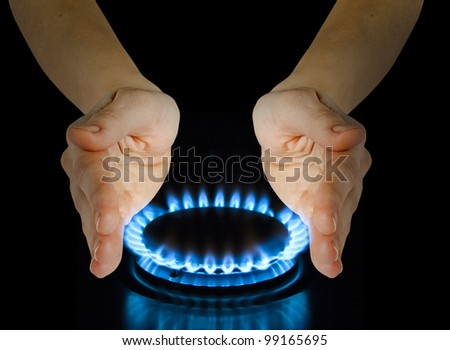 blue gas in hands on the black - stock photo