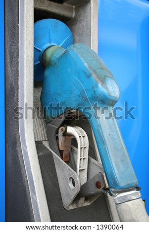 Blue gas pump hanging in it's cradle - stock photo
