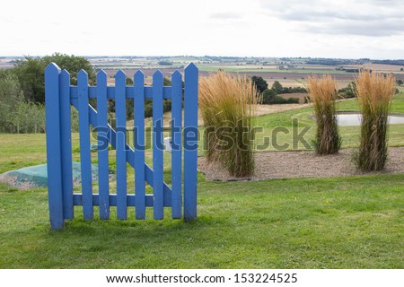 blue gate to countryside - stock photo