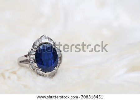blue gem and diamond ring