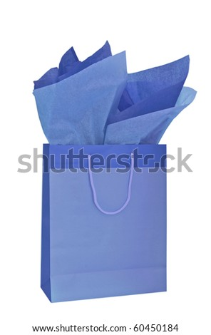 Blue gift bag with tissue paper isolated on a white background - stock photo