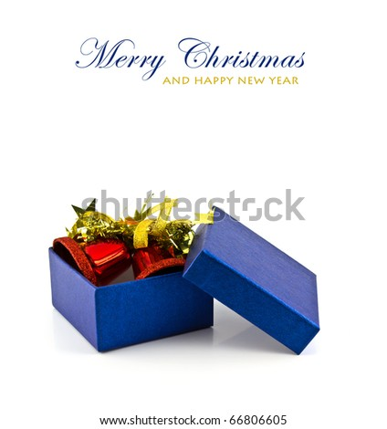 Blue gift box and bell on white background with copy space. - stock photo