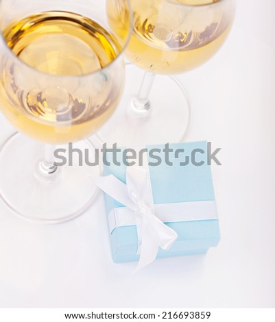 Blue gift box and glasses of champagne - stock photo