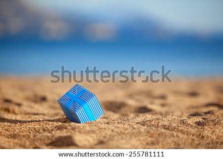 Blue gift box on a beach - stock photo