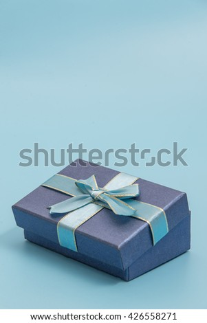 Blue gift box on blue colour background use for national holiday, copyspace for text - stock photo