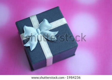 Blue gift box on purple background