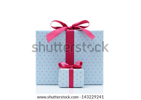 blue gift box on white background. Different sizes of the same shape gift box. A small gift box with a big gift box.  - stock photo