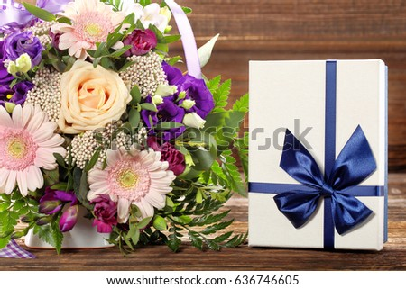 Blue gift box with beautiful bouquet of flowers with space for inscription