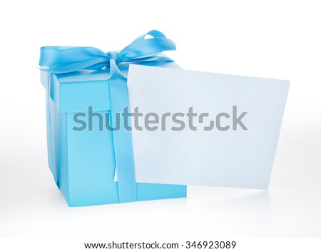 Blue gift box with blank greeting card envelope on a white background - stock photo