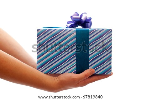 Blue gift box with bow in man's hands. Isolated on white - stock photo