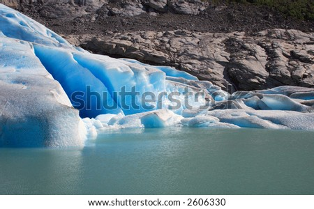 Blue glacier (Briksdalsbreen Glacier in Norway, Scandinavia) in detail - stock photo