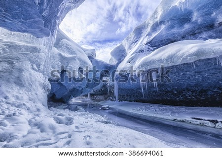 Blue glacier cave in Iceland - stock photo