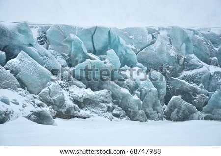 Blue glacier in cold snowy winter day, Greenland - stock photo