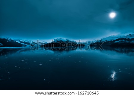 Blue glaciers in the College Fjord passageway, Alaska - stock photo