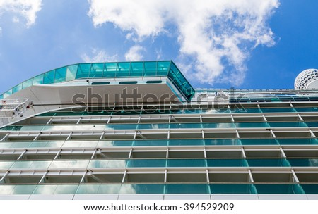 Blue Glass Balconies on Cruise Ship Under Suny Sky