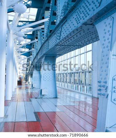 blue glass corridor in office center - stock photo