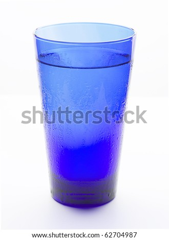 Blue glass filled with cold water - stock photo