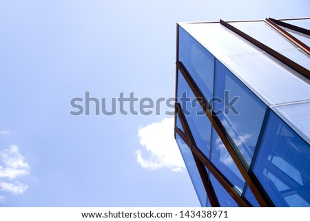 blue glass high-rise building - stock photo