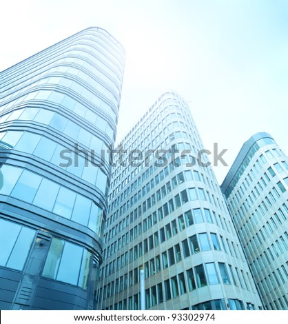 blue glass silhouettes of skyscrapers in the morning - stock photo