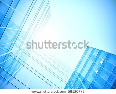 blue glass skyscraper perspective view - stock photo