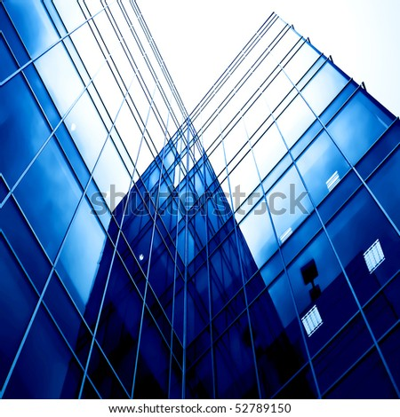 blue glass transparent wall of new modern building skyscrapers - stock photo